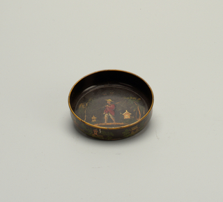 Flat bottom, vertical sides. Black field, decorated in gilt, red, brown and green with Chinese scenes on outside of sides; on bottom, Chinese coolie carrying a yoke.