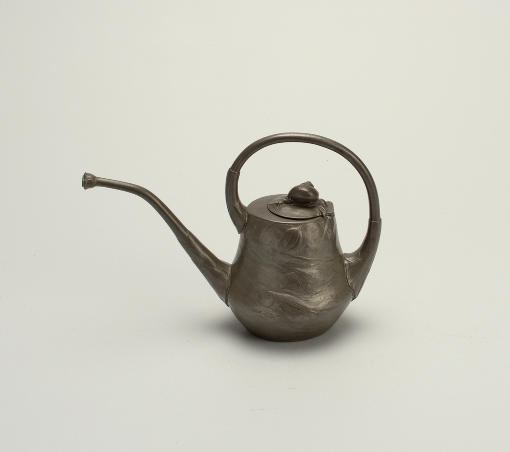 with undulating truncated pear form, cast in relief with fish and flowers in water,  the angled spout extending from near the base, the handle as a C-shaped form going over the cover, with bud finial.
