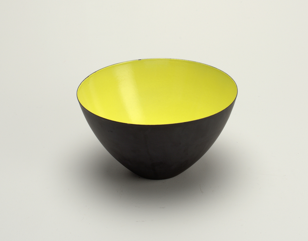 Tall steel bowl with green enameled interior.