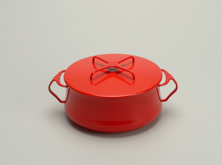 "Two-quart ""Kobenstyle"" casserole. (a) Deep, round red enamel dish with handles on sides. Handle of cover formed in shape of an X. Inside of both A and B coated in white enamel."