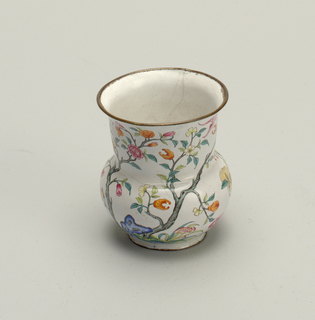 A copper vase with floral enamel decoration.