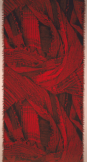 Length of woven cotton with a trompe l'oeil image of randomly arranged strips of crinkled fabric, in red and black.