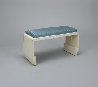 Rectangular wooden bench (a); slip seat cushion covered in blue lattice work fabric (b).