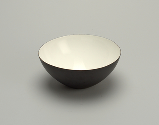 Steel bowl with white enameled interior.