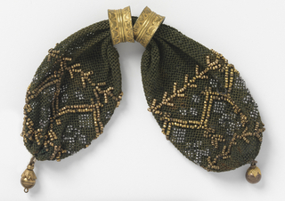 Dark crocheted silk ornamented with gold beads in zigzag and stylized branch pattern.  Accents of very small cut steel beads.  Two gold rings control side opening; gold ball drops at either end.