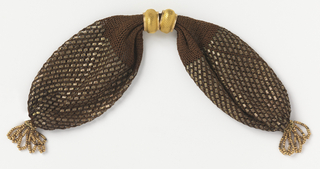 Dark brown netting silk ornamented with small flat rectangular gold paillettes in overall pattern. Gold rings with scale pattern control side opening; gold bead tassels at either end.