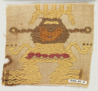 Fragment of a funerary mantle in light brown cotton plain cloth ground (doubled warps) with figure of a man brocaded in yellow, red, brown, orange and tan.