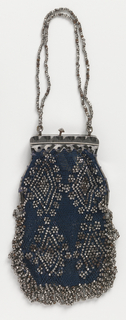 Small flat bag of crocheted blue silk with cut steel beads in a diamond pattern, fringed with cut steel beads. Set into frame of cut steel with catch, and chain of  cut steel beads.