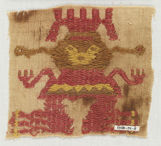 Fragment of a funerary mantle in light brown cotton plain cloth ground (paired warps) with figure of a man brocaded in yellow, red, and brown wools