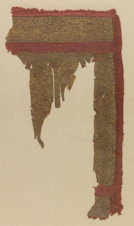 Irregular fragment with an incomplete design of scrolls.
