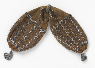 Light brown crocheted silk ornamented with cut steel beads in simple pattern of connected rectangles. Very small cut steel rings control side opening; small bead tassels at either end.