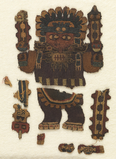 Fragments of a standing human figure wearing a mask, headdress and holding serpent staffs.  Completely embroidered in strong colors.