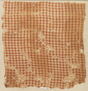 Checkerboard fabric in red and tan. Linen is tan, the silk is red.