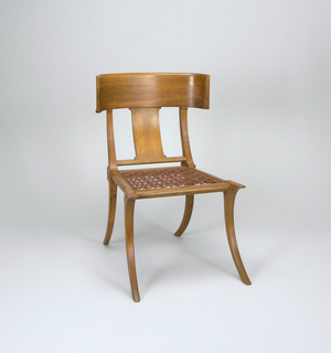 Side chair with concave backrail and leather webbed seat, raised on splayed, tapering legs; backrail is supported by a back splat of similar thickness, placed perpendicular to the crest rail.