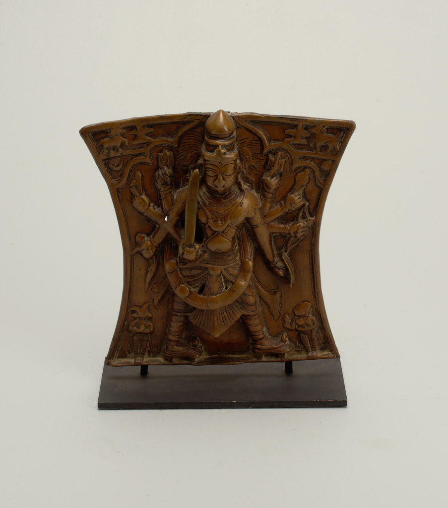 Armed deity; standing