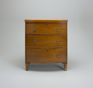Sheraton satinwood bow front chest of drawers, three deep drawers.