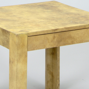 Two rectilinear coffee tables covered with parchment.