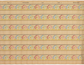 Narrow border containing a repeating anthemion-like motif. A red and pink motif alternates with a blue and green motif. Printed six across on a background of very small wavy white lines and mica pin dots. On ungrounded paper.