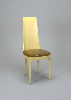 Rectangular, tapering, high back finishing off in a flat line at top.  Frontal legs straight, back legs curving outwards.  Seat upholstered; the curving seat frame continuous with the chair's back and legs is visible.