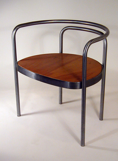 Two steel tubes curved to form parallel bars for back, arms and straight legs; seat of plain plywood.