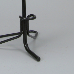 White molded fiberglass seat rising to high narrow rectangular back, mounted on chrome-plated steel post housed in black, bent tubular steel base with small loop as footrest; post can be raised and lowered; dial to lock and unlock post located under seat.