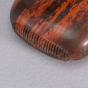 Oblong, curved sides, top and bottom, molded from vulcanite, featuring irregular red and black striations throughout entire surface. Slip-top cover may be removed entirely. Striker molded into box bottom.