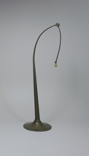 Bronze base (a) with circular foot rising to tapered shaft with long, curved, hinged arm; broad conical parchment shade (b) suspended from end of arm.