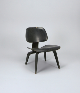 Molded bentwood seat and back, raised on molded bentwood legs.