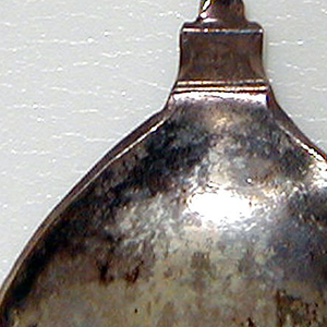 Rounded bowl, revese engraved with curving, foliate terminated initialled band. Twisted stem wtih ball terminal engraved with four-petalled blossom at top.