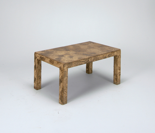 Rectangular coffee table in mottled textured finish.