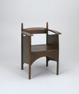 Cube-form with narrow, flat, slightly curved seat rail, flat out-curving arms, turned upright, paneled sides; square dish-carved seat with arched apron; four tapering cylindrical legs.