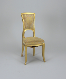 This set of side chairs has contour-edged and gilded frames.  The chairs have arched back rails, incurved side rails, and gently pointed front feet that rest on supports.  The rear legs are square.  Both chairs have identical needlepoint backs in multicolor pastel showing round flowers, vines, and leaves.  The designs are on ivory ground.  The chairs form a set with 1969-71-1,2.