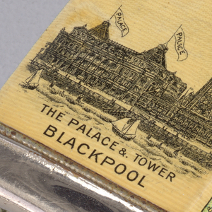 "Rectangular, with curved corners, featuring printed decoration of coat-of-arms in black, gold, blue, red, silver, against beige ground, inscribed above ""Blackpool"" and below, inside banner ""Progress""; reverse features image of large 19th century style building with 2 turrets, each with flag inscribed ""Palace"" and adjacent steel tower with flag inscribed ""Tower"", all situated on coast with beach, people, water and sailboats in foreground, inscribed below ""The Palace & Tower, Blackpool."" Side panel printed in light green, with red and black cartouche, inscribed in center ""C.E B. & Co., REGD. No.430409"", below cartouche inscribed ""Printed in Rhineland."" Opposite side panel green with red and black decorative cartouch. Lid hinged on side, inscribed on lid ""Wm  Rawlinson,"" thumb catch on opposite side. Striker in recessed groove on bottom."