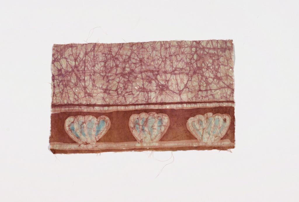 Field of pinkish-mauve crackle pattern on undyed ground. Medium-sized plain pinkish brown border on one side with three stylized flower profiles reserved in pinkish field with pale blue petals. Reserved guard strips with crackle pattern.