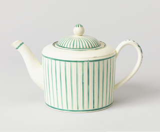 Gently conical body with slightly domes shoulder, curved spout, ribbed strap handle. Cover is domes with pointed knob. Body and cover are ribbed and striped with green.