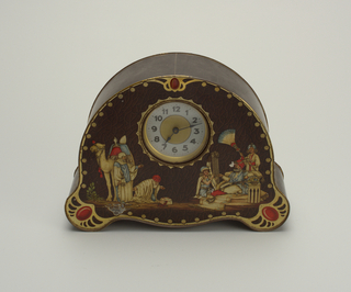 Tin shaped like a mantle clock with Turkish figural scene.
