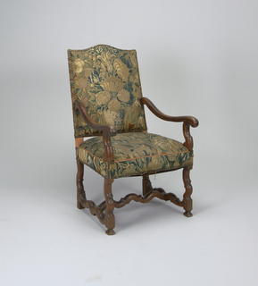 Open armed armchair, back and seat covered in tapestry attached via brass buttons, curvilinear legs and stretchers at base. Chair's armrails depart from halfway up chair-back, dipping and swinging outwards.
