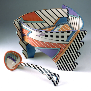 Curved triangular porcelain bowl and ladle built with abstracted slabs. Painted in black, white, purple/blue and orange/red colors in abstracted shapes with stripes.