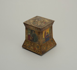 Renaissance style tin resembling scrolling repoussé metalwork with colored gems. Square panels with figural scenes.