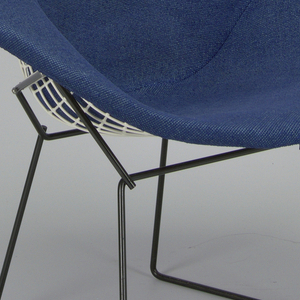 Diamond shaped white-coated metal wire mesh seat unit with blue woven upholstery; black-coated wire stand.