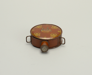 Tin shaped like a boy scout's canteen decorated with rope knots and bugle.