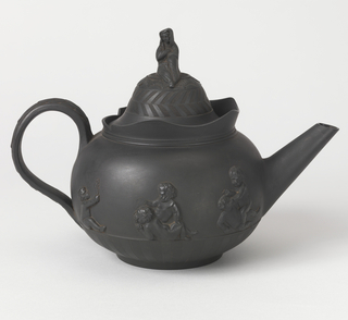 Flattened spherical shape with wide, looped handle and conical spout. The high domed cover had knob composed of a draped female figure. Lower portion of pot is decorated with rays in low relief, sides with high relief groups of Bacchanalian putti and handle with leaf ornament. Thin shaped collar about mouth. Leaf and chevron reliefs on cover. Inside glazed.