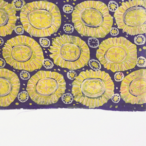Design of offset rows of floral medallions in yellow on dark blue background.