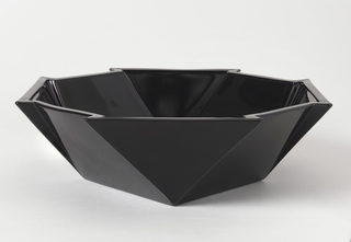 "Octogonal bowl with jagged rim and flared sides. ""Ebony"" color."
