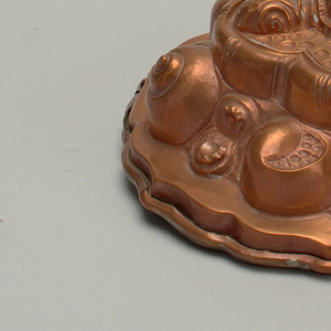Decorated in repoussé with snails and a turtle.