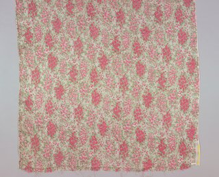 Sheer dress fabric with bunches of roses in pinks and muted green leaves printed on white ground.