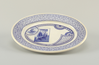 Oval form, the white crackled ground decorated with blue Japanese-inspired tranfer-printed decoration: the rim with a wide band of abstract geometric design, with fine hatched lines, surrounding a narrow scalloped band; the well decorated with bands, medallions and panels of geometric motifs, a medallion showing a sailing vessel on water superimposed on a landscape within a rectangular frame.