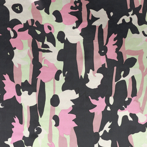 Printed in pink, rose, light green and black against white background. Allover design of stylized narcissus flower elements.