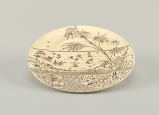 Circular form, the white crackled ground with brown Japanese-inspired transfer-printed decoration, the top section showing birds in flight over a body of water, shoreline with tree and flowering plants in foreground, the lower section composed of differently shaped panels of motifs including night sky, flowers, and geometric or arabesque patterns.