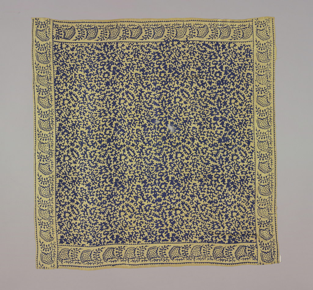 Yellow square with highly conventionalized design of plant forms in dark blue. Initials IAW embroidered in tiny red cross stitch in one corner.